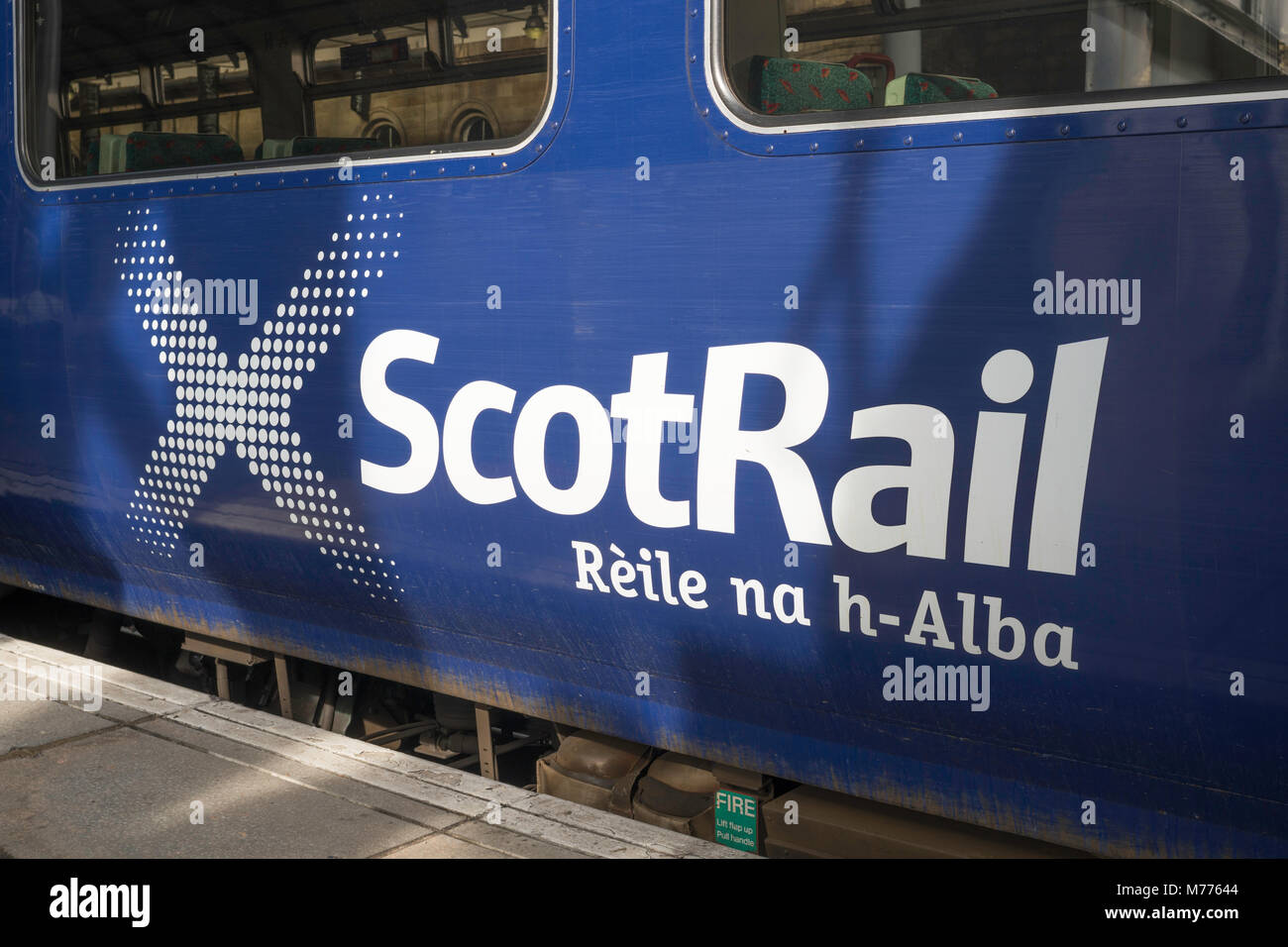 ScotRail logo on the side of a carriage with Gaelic Rèile na h-Alba (Scotland's Railway) - Stock Image
