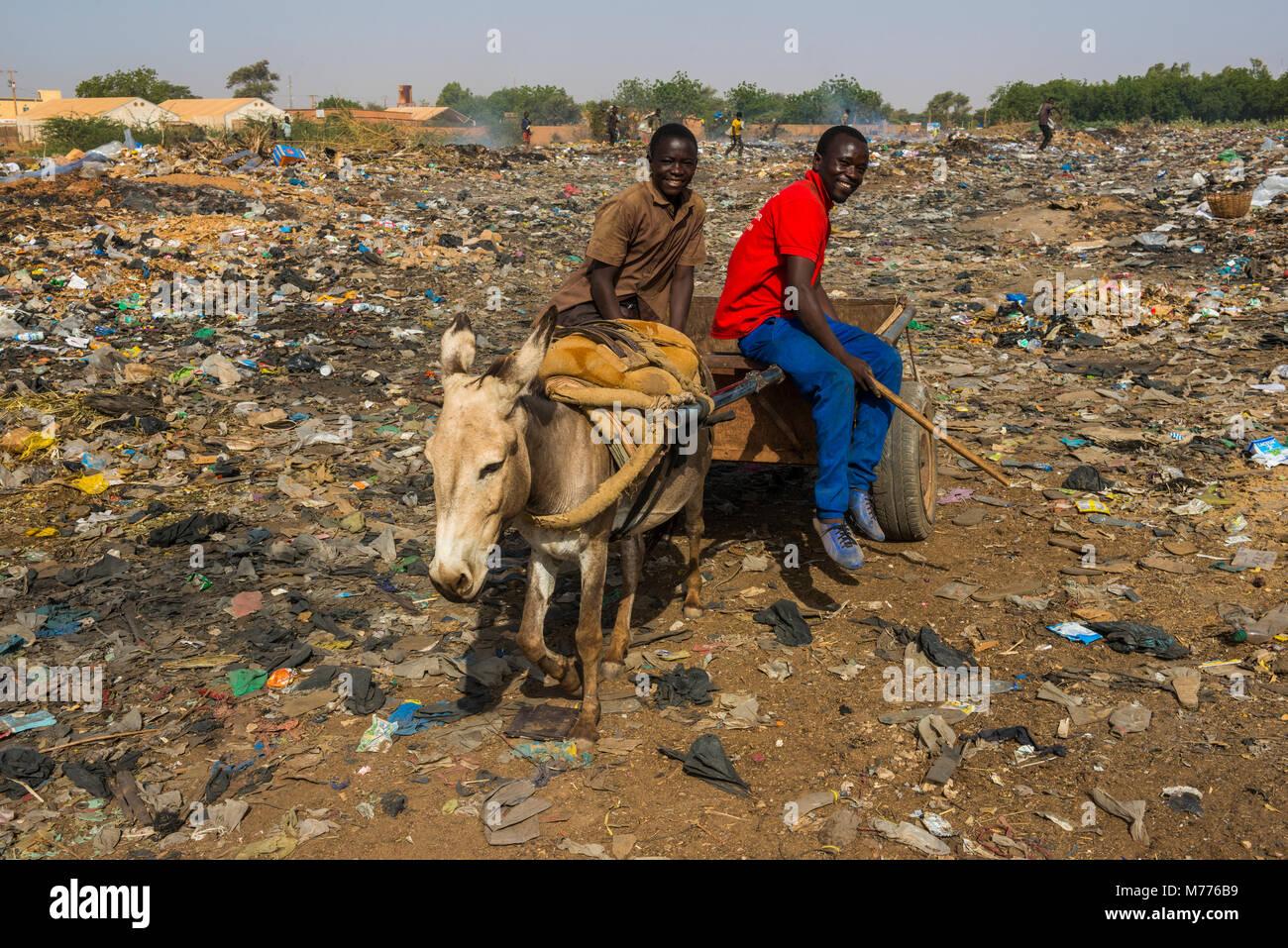 Friendly boys on a public rubbishdump, Niamey, Niger, Africa - Stock Image