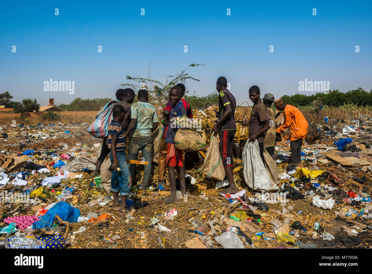 Local boys looking for valuables in the public rubbish dump, Niamey, Niger, Africa - Stock Image