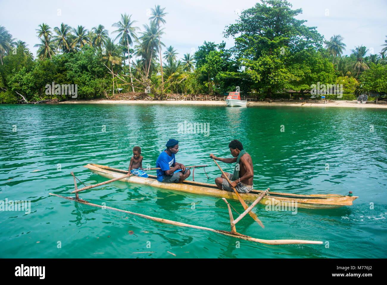 Locals in a dugout canoe, Kavieng, New Ireland, Papua New Guinea, Pacific - Stock Image