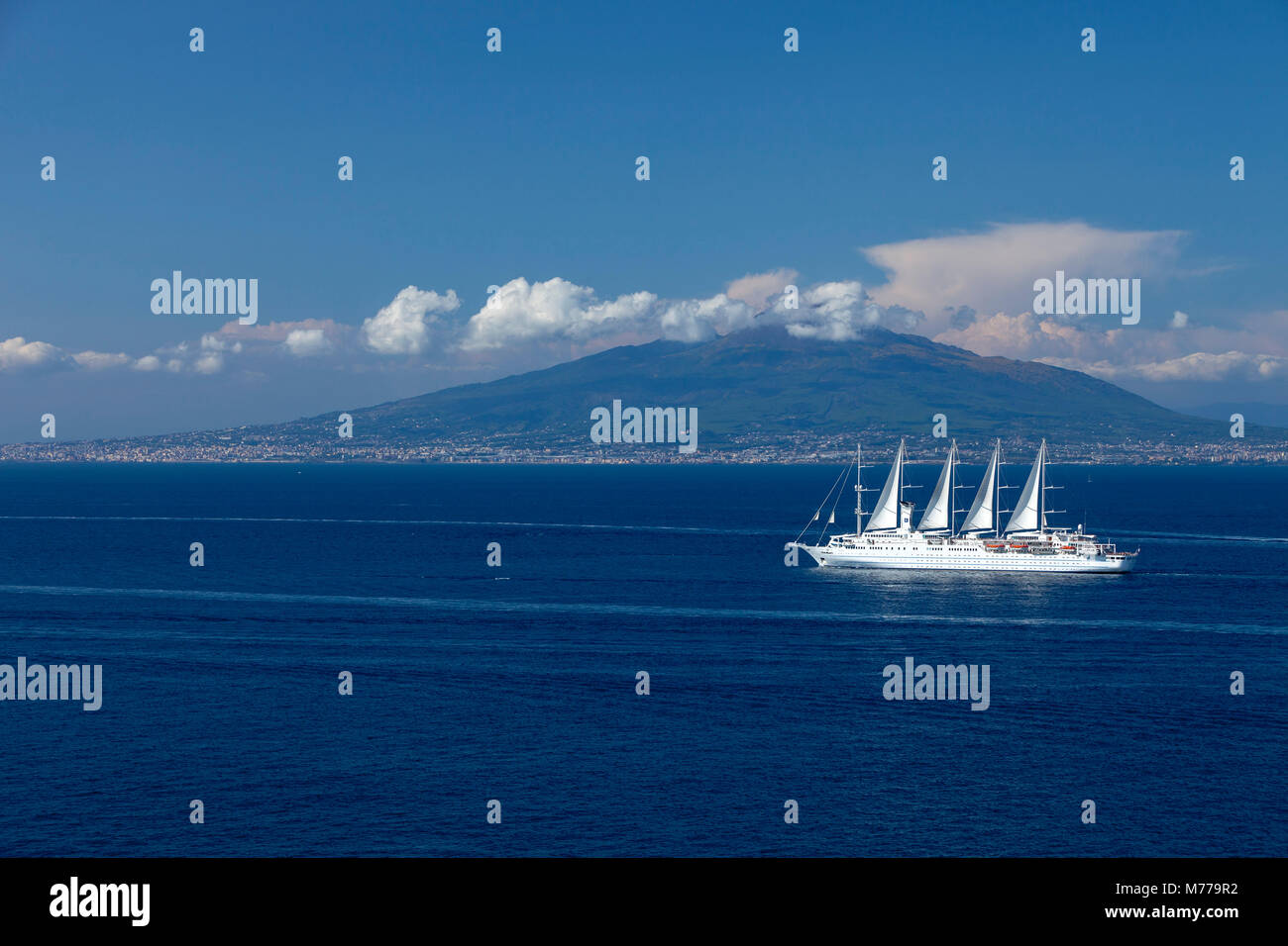 Mount Vesuvius from across the Bay of Naples with Wind Surf cruise ship in foreground, Campania, Italy, Europe - Stock Image