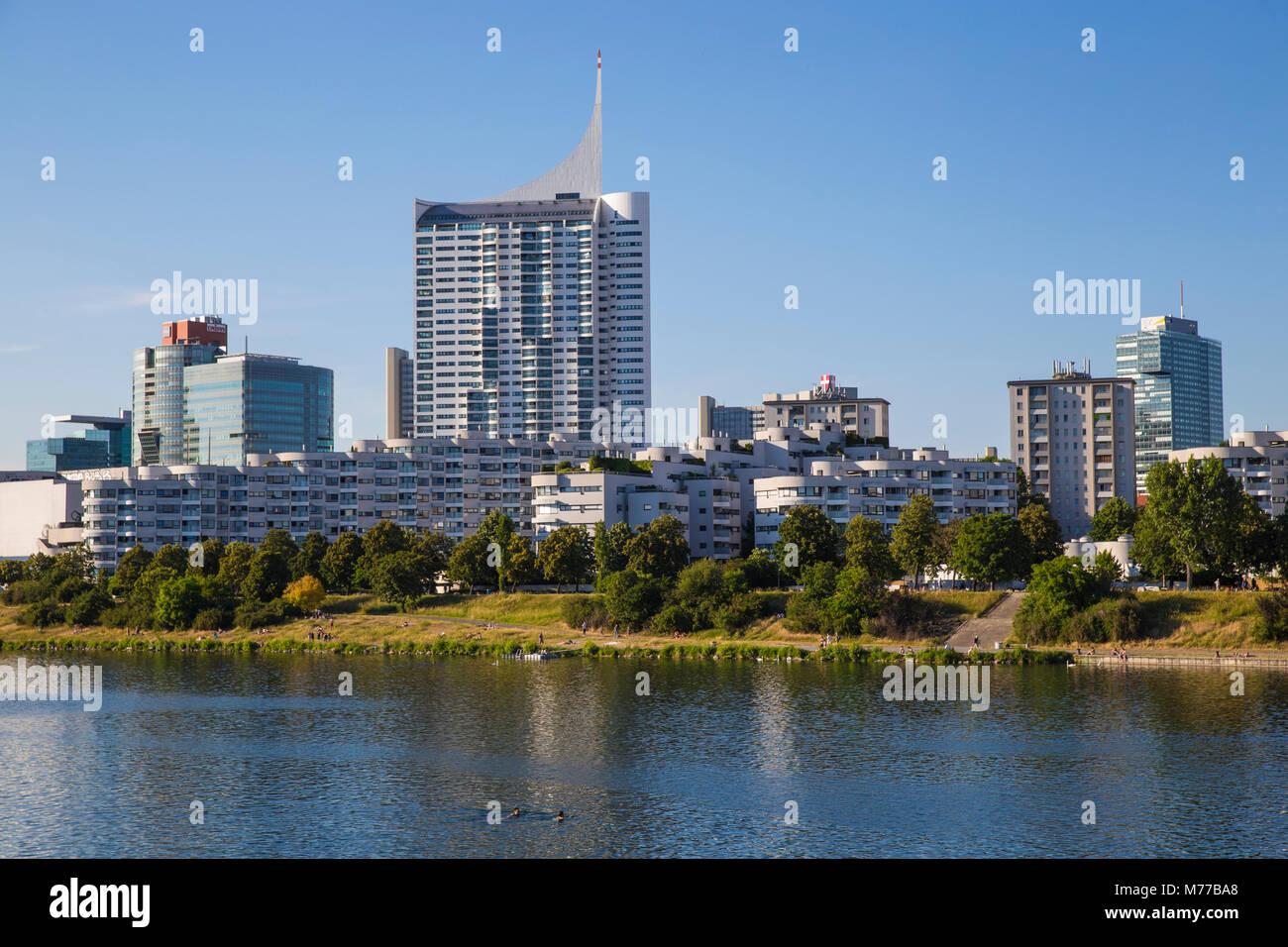 Donau City reflecting in New Danube River, Vienna, Austria, Europe - Stock Image