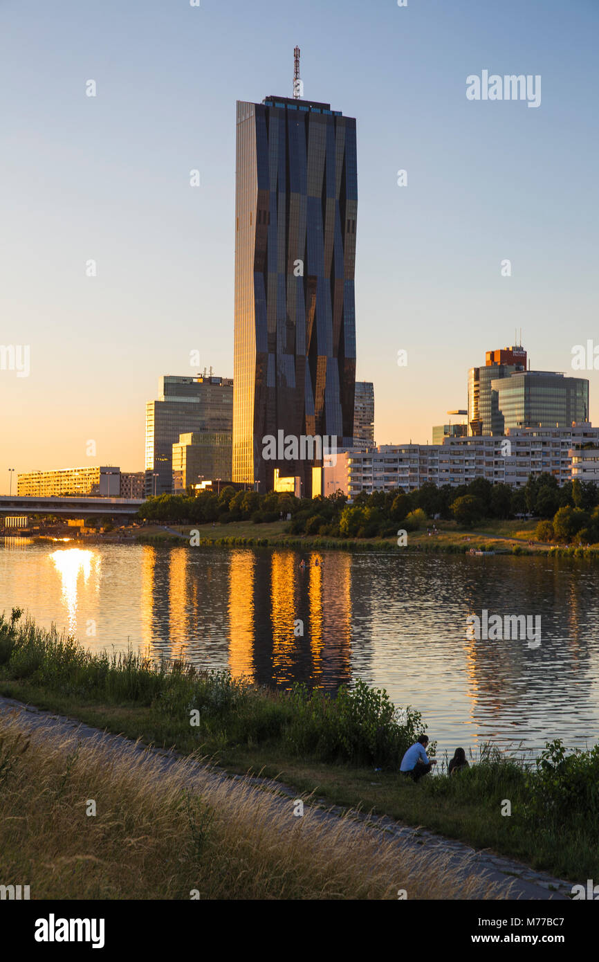 Donau City and DC building reflecting in New Danube River, Vienna, Austria, Europe - Stock Image