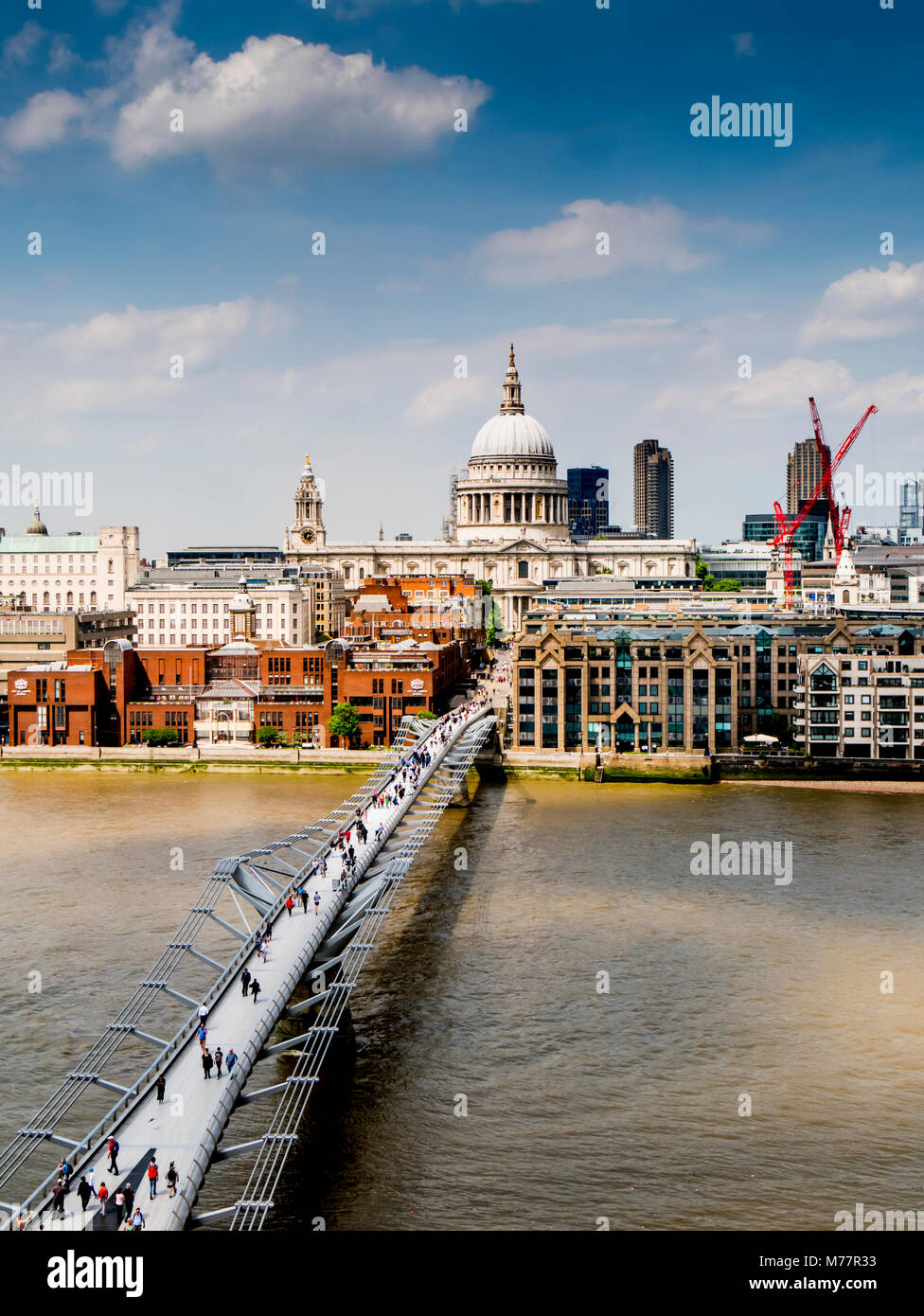 St. Paul's Cathedral and Millennium Bridge from the Tate Gallery, London, England, United Kingdom, Europe - Stock Image