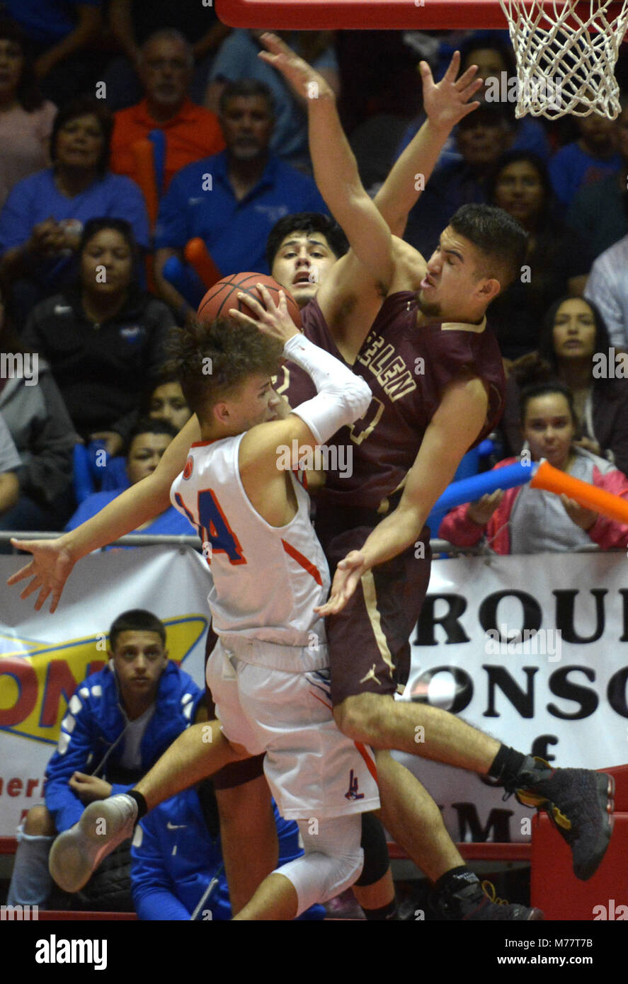 U.S. 8th Mar, 2018. SPORTS -- Belens' Alexis Aguilar, center, and Matthew Padilla, right, blocks Los Lunas' Joe Dominguez, 14, during the 5A State semifinal boys basketball game in the Pit on Thursday, March 8, 2018. Credit: Greg Sorber/Albuquerque Journal/ZUMA Wire/Alamy Live News Stock Photo