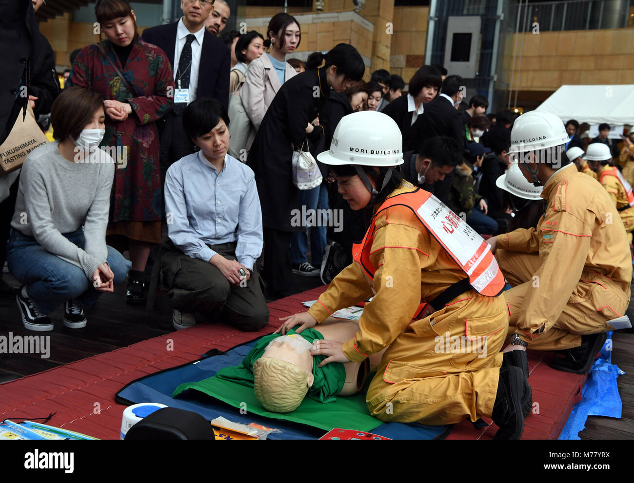 Tokyo, Japan. 9th Mar, 2018. People receive a first-aid lesson during a disaster drill in Tokyo, Japan, March 9, - Stock Image