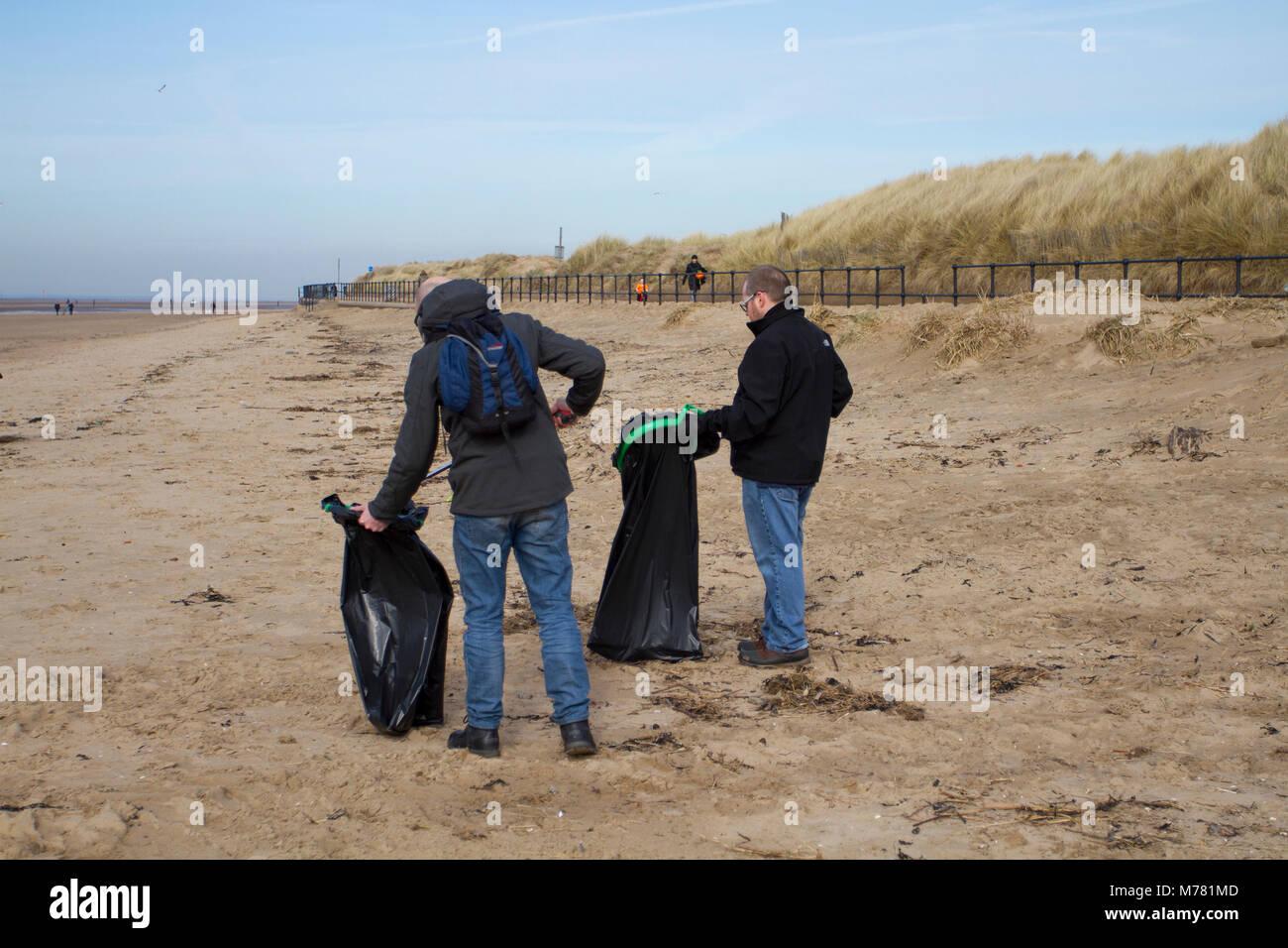 Crosby, Merseyside.  UK Weather. 9th March, 2018.  Network rail 'Social Responsibilty' volunteers beach - Stock Image