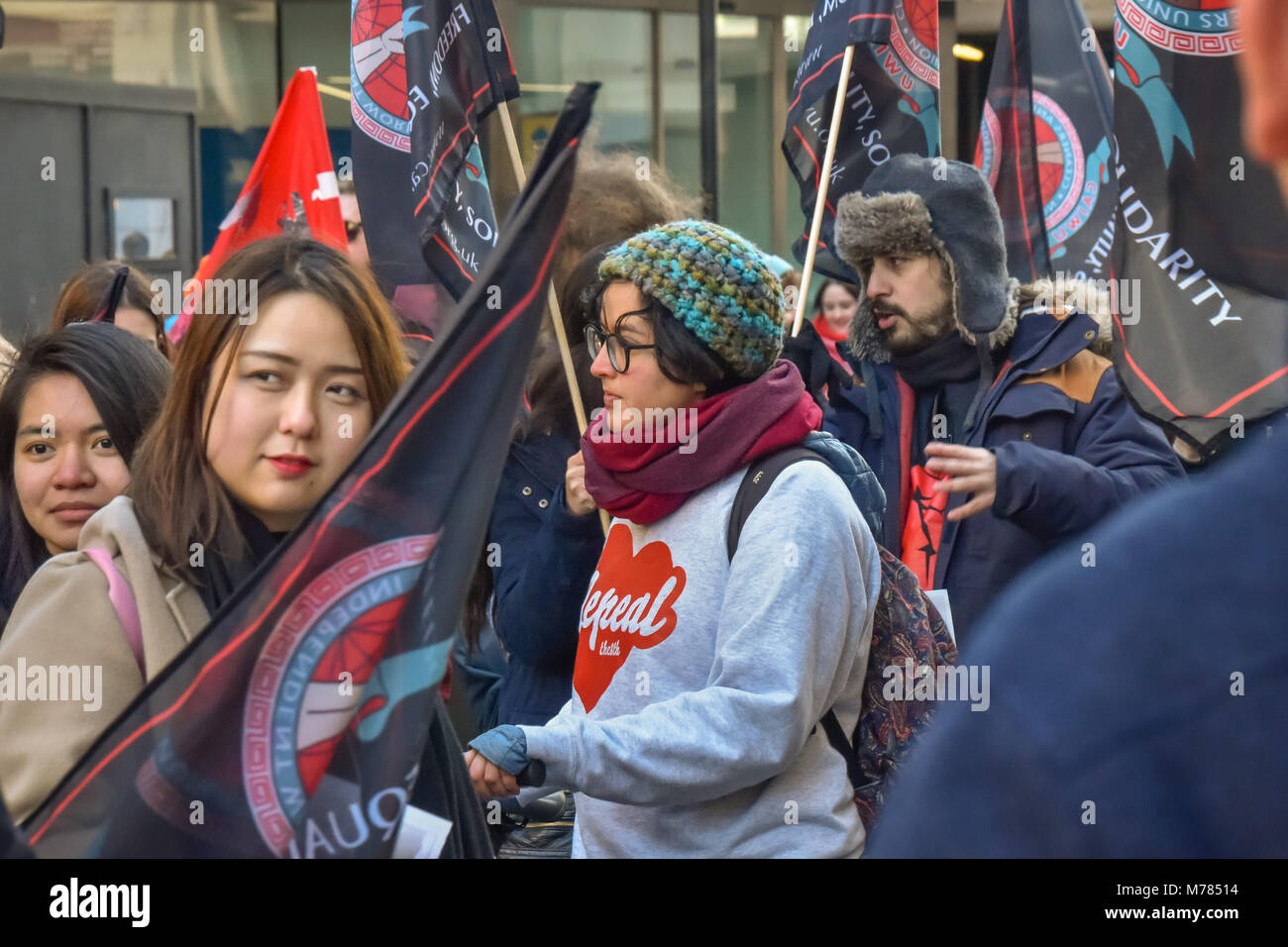 London, UK. 8th March 2018. Cleaners from CAIWU were supported by a a large crowd from the London Womens's Strike Stock Photo
