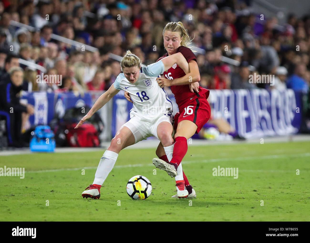 Orlando, Florida, USA. 7th Mar, 2018. England forward Ellen White (18) battles for ball possession with Unites States - Stock Image