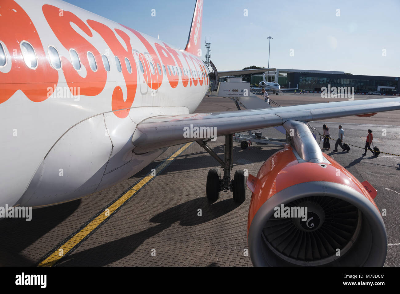 EasyJet plane waiting for passengers to board, Luton Airport, UK - Stock Image