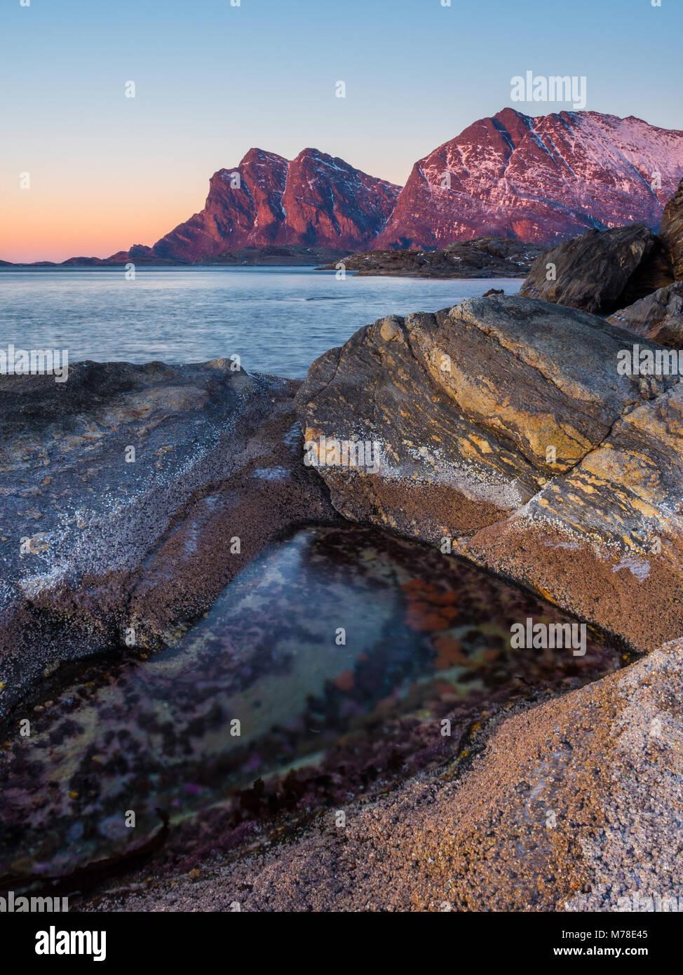 The mountains of Kjerringøy in the winter sunset - Stock Image