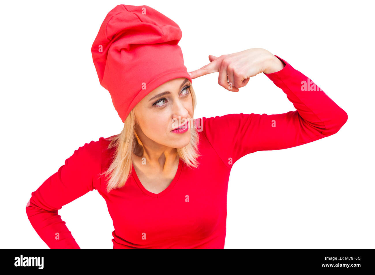 Dressed in red woman with finger gun hand sign against her temple isolated on white background Stock Photo
