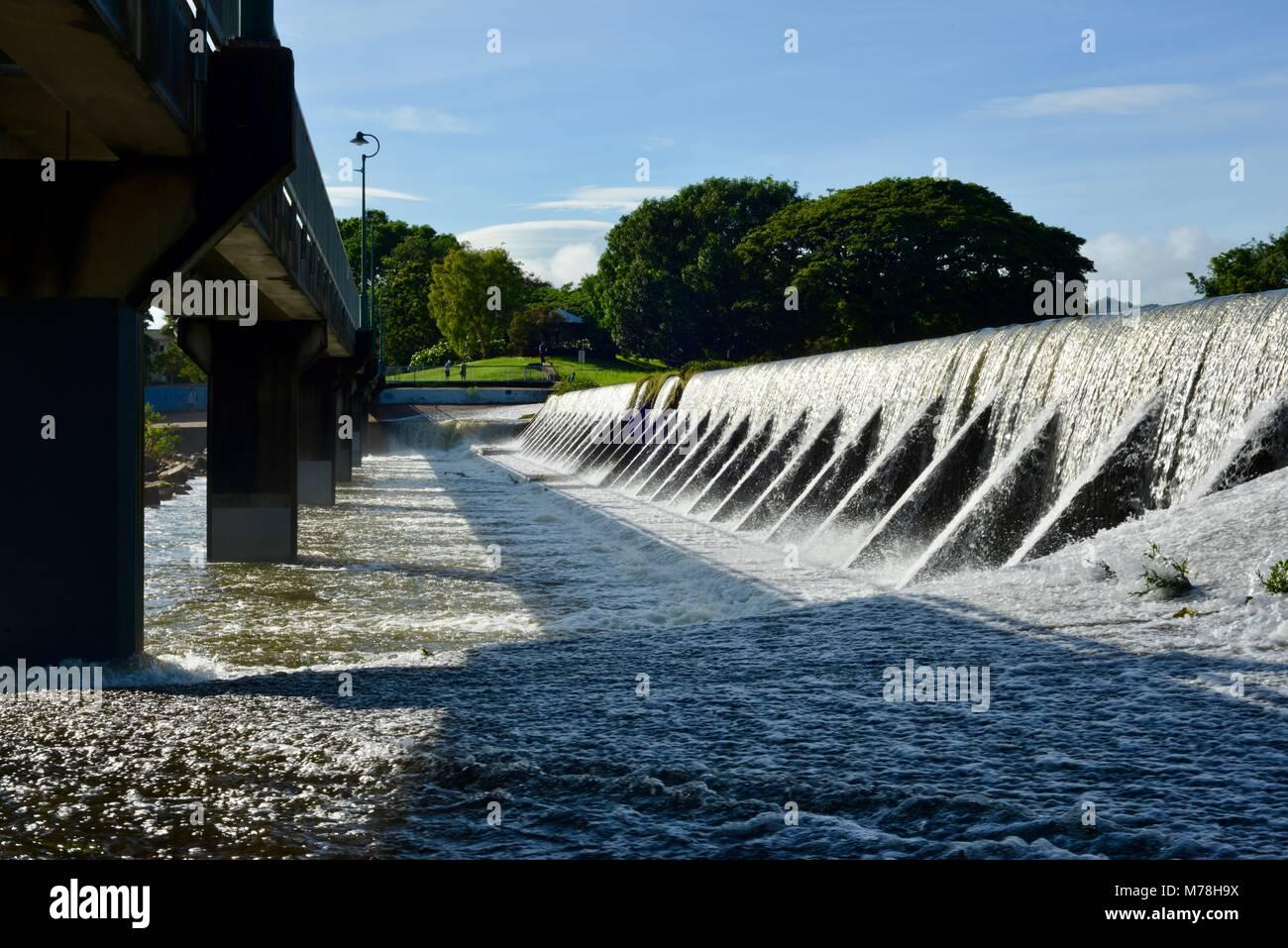Water cascades over Aplins weir after storms and heavy rainfall, Aplins weir, Townsville, Queensland, Australia - Stock Image