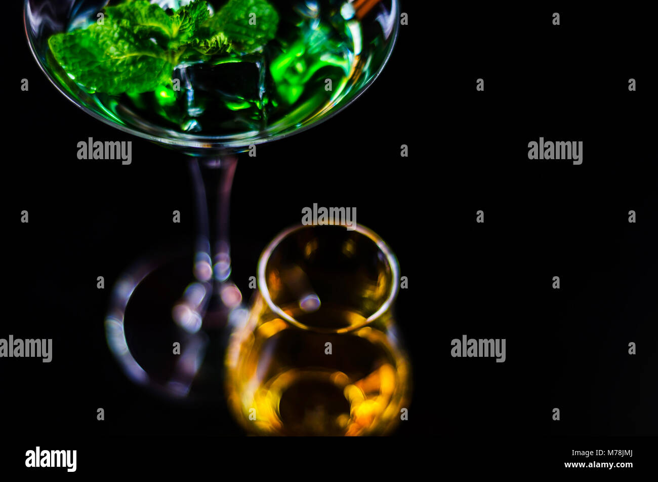 single malt whiskey in a glass and green mint liqueur, refreshing set of drinks, taste sensations - Stock Image