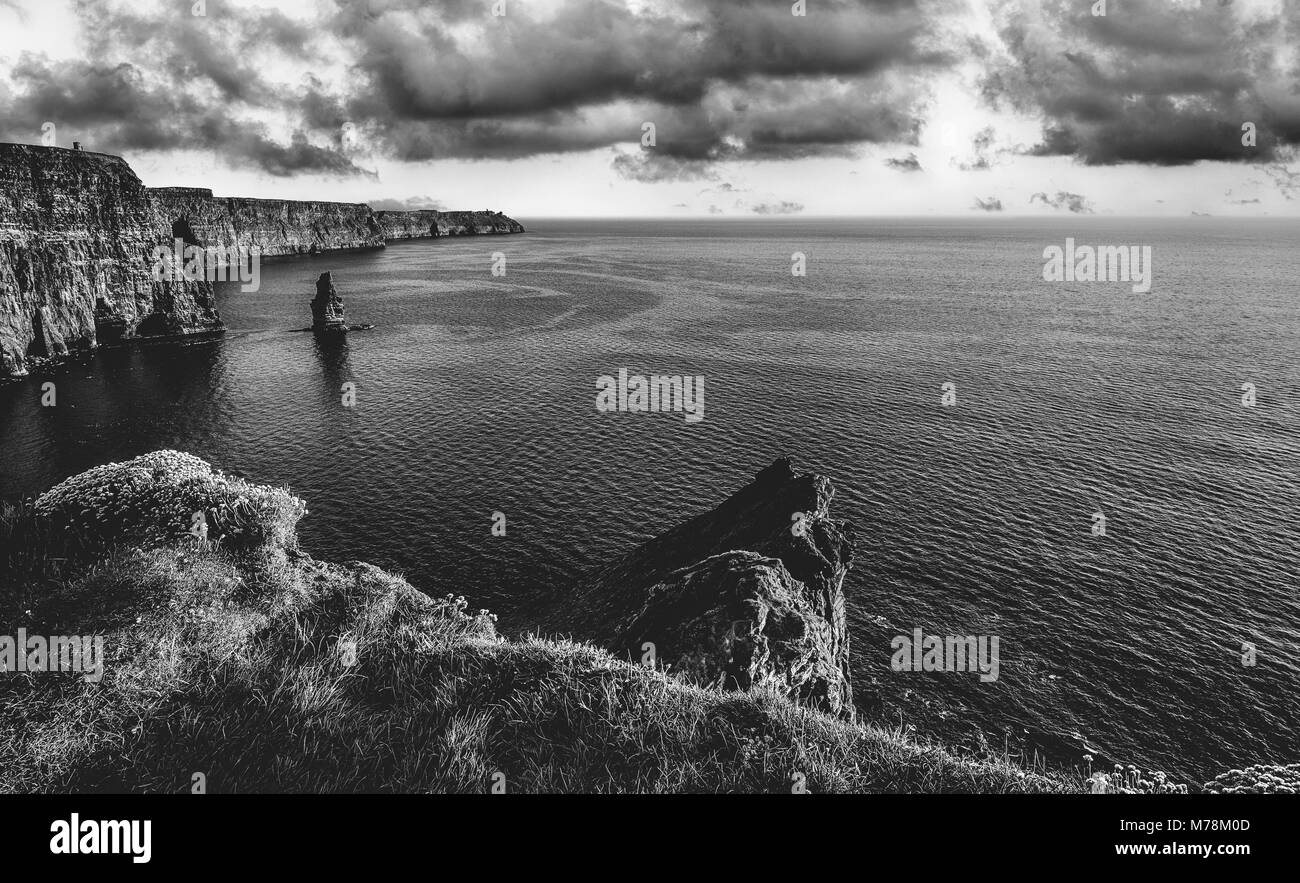 Epic black and white photograph of the world famous cliffs of moher in county clare ireland