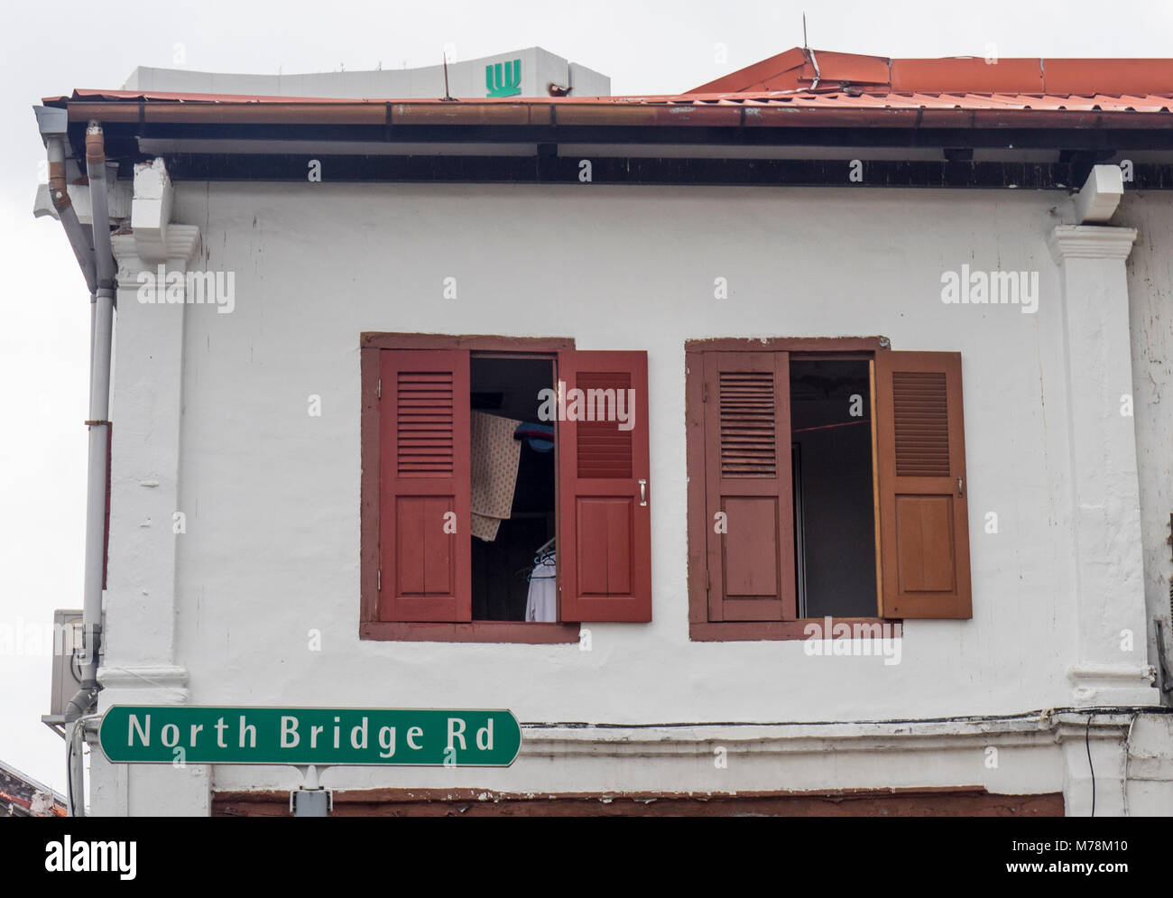 Window shutters of the upper storey of a traditional shophouse on North Bridge Rd, Singapore. - Stock Image