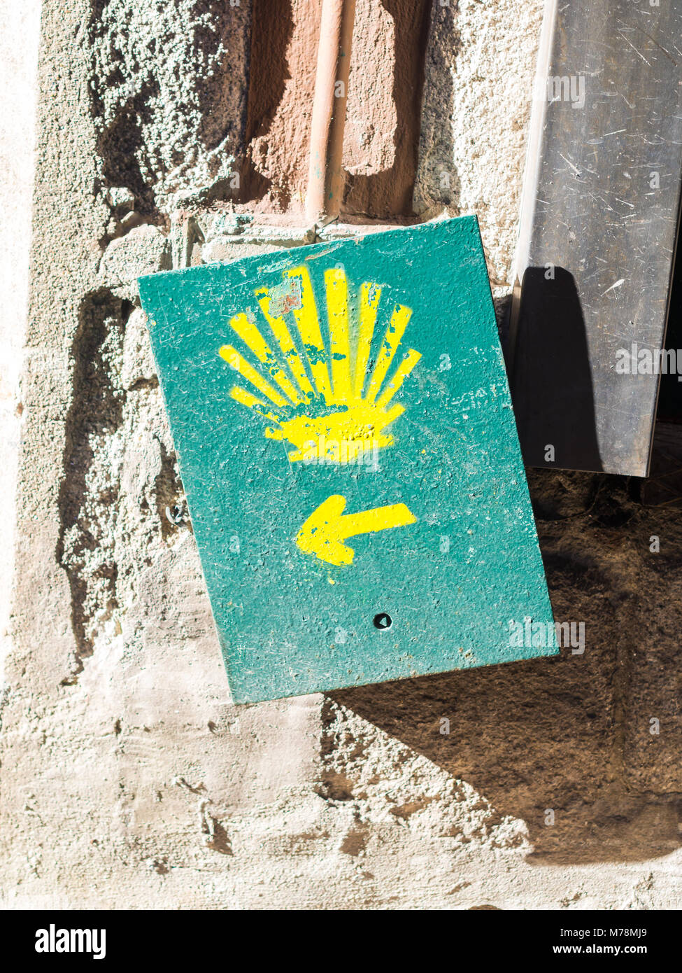 The yellow scallop shell signing the way to Santiago de Compostela in Porto, on the Saint James pilgrimage route. - Stock Image