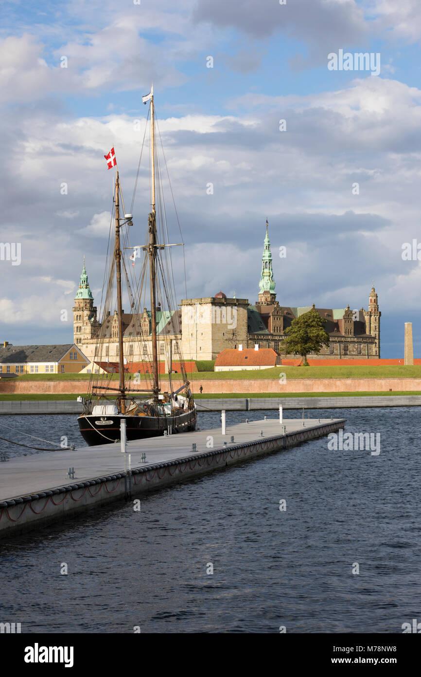 Tall ship in harbour with Kronborg Castle used as setting for Shakespeare's Hamlet, Helsingor, Zealand, Denmark, Stock Photo