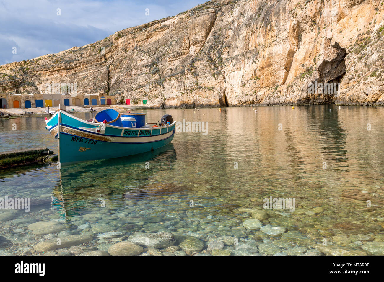 Traditional boat in the harbour at Dwejra Inland Sea in Gozo, Malta, Mediterranean, Europe - Stock Image