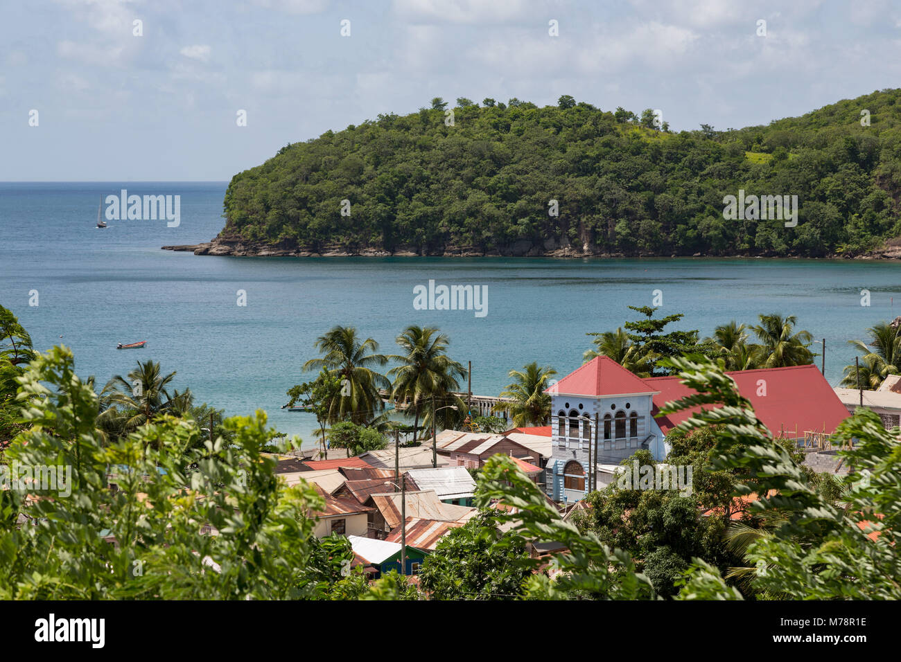 Church in the small town of Canaries, with Canaries Bay beyond, St. Lucia, Windward Islands, West Indies Caribbean, - Stock Image