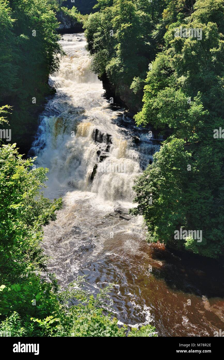 The Falls of Clyde in full flow near the town of New Lanark, South Lanarkshire, Scotland, UK - Stock Image