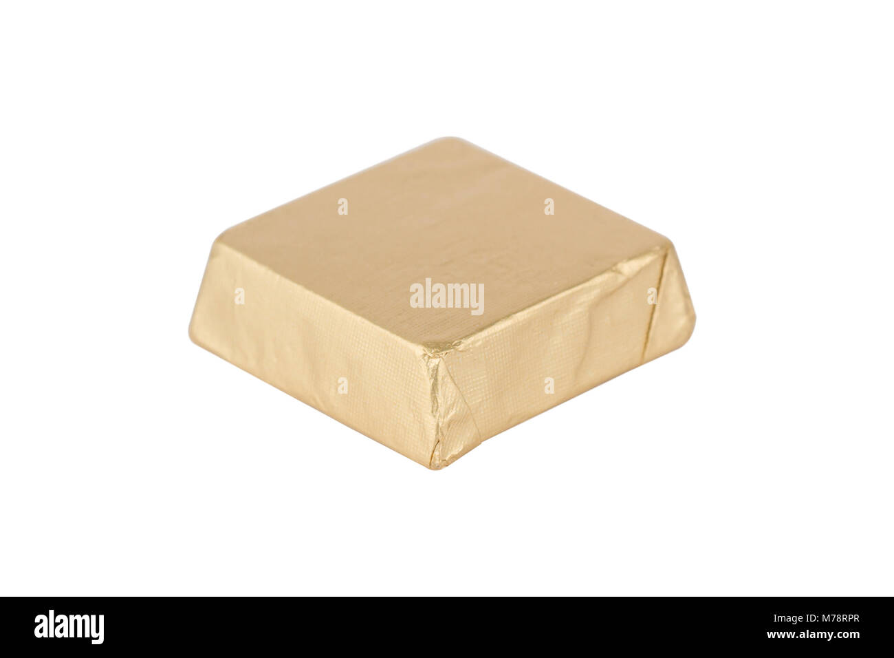 Top View Closeup Of Chocolate Candy Bar Wrapped In Golden Foil Stock