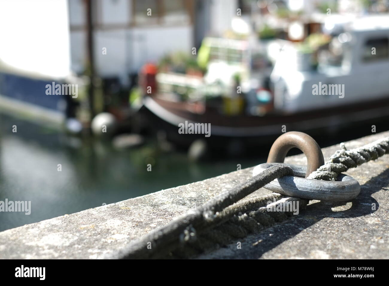 Close-up of boat mooring cleat on wall of Grand Union canal - Stock Image