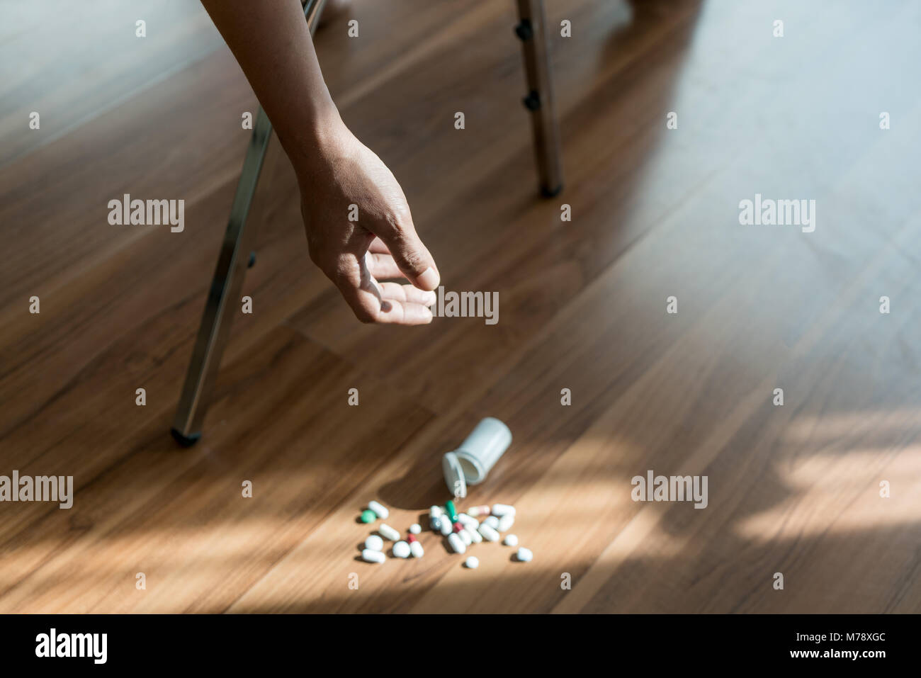 The man committing suicide by overdosing on medication. Close up of overdose pills and addict. - Stock Image