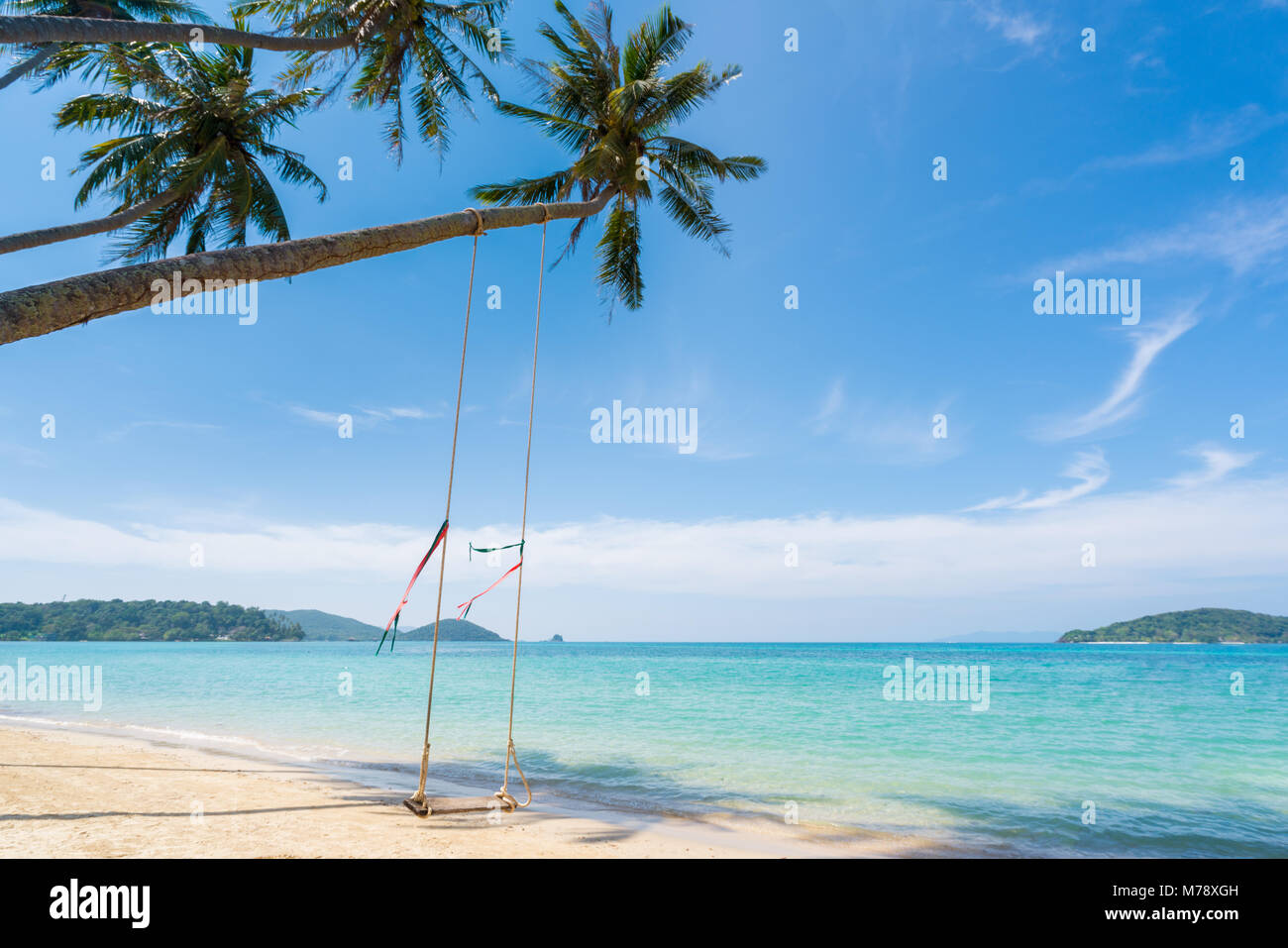 Swing hang from coconut palm tree over summer beach sea in Phuket ,Thailand. Summer, Travel, Vacation and Holiday - Stock Image