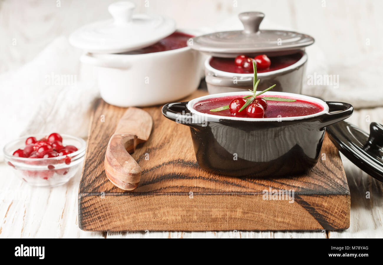 Fresh homemade chicken liver pate (rabbit, goose) with cranberry sauce. Gourmet appetizer. Selective focus - Stock Image