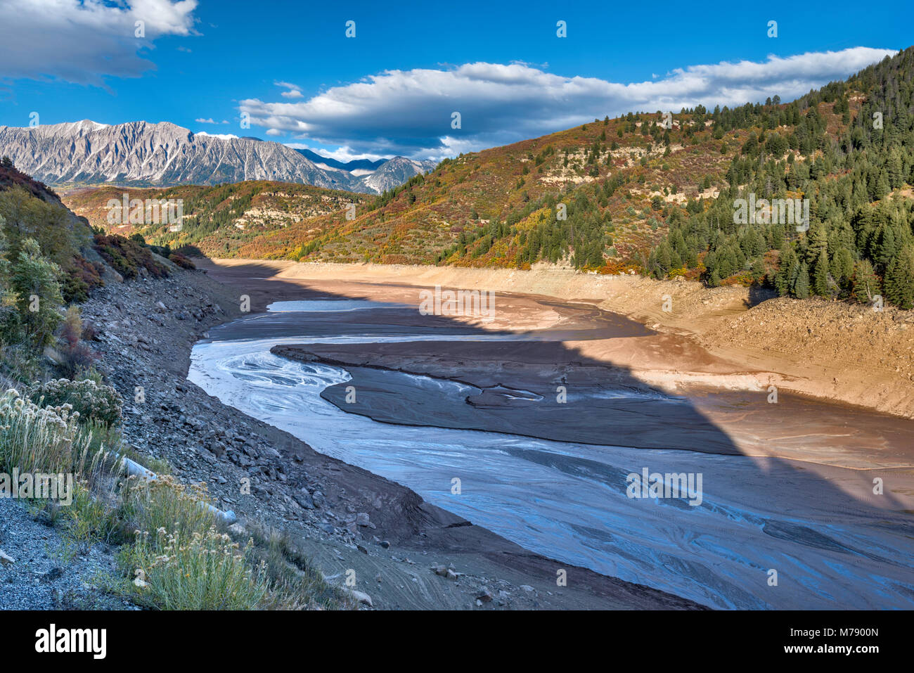 Drained Paonia Reservoir, on Muddy Creek in October 2013, extremely low water levels due to draught, West Elk Mountains, - Stock Image