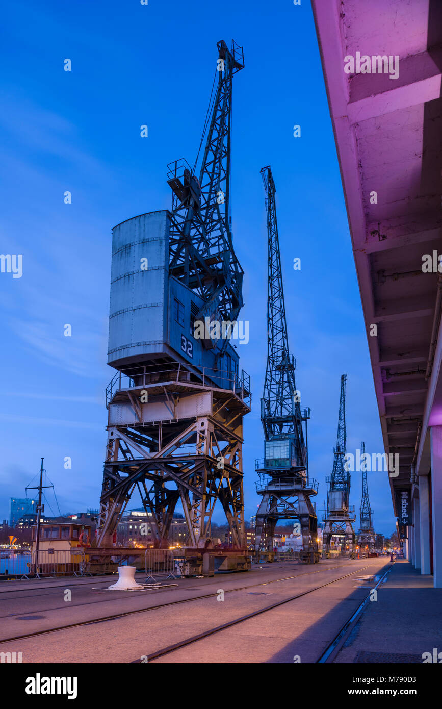 Cranes and the Bristol Harbour Railway at Princes Wharf outside the M Shed Museum beside the Bristol Floating Harbour, - Stock Image