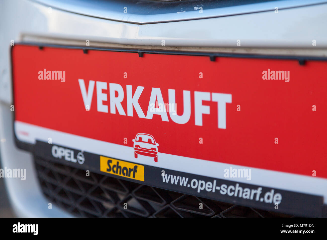 NUERNBERG / GERMANY - MARCH 4, 2018: German word verkauft, sold on a car tag at an Opel car dealer in Germany. Opel Stock Photo