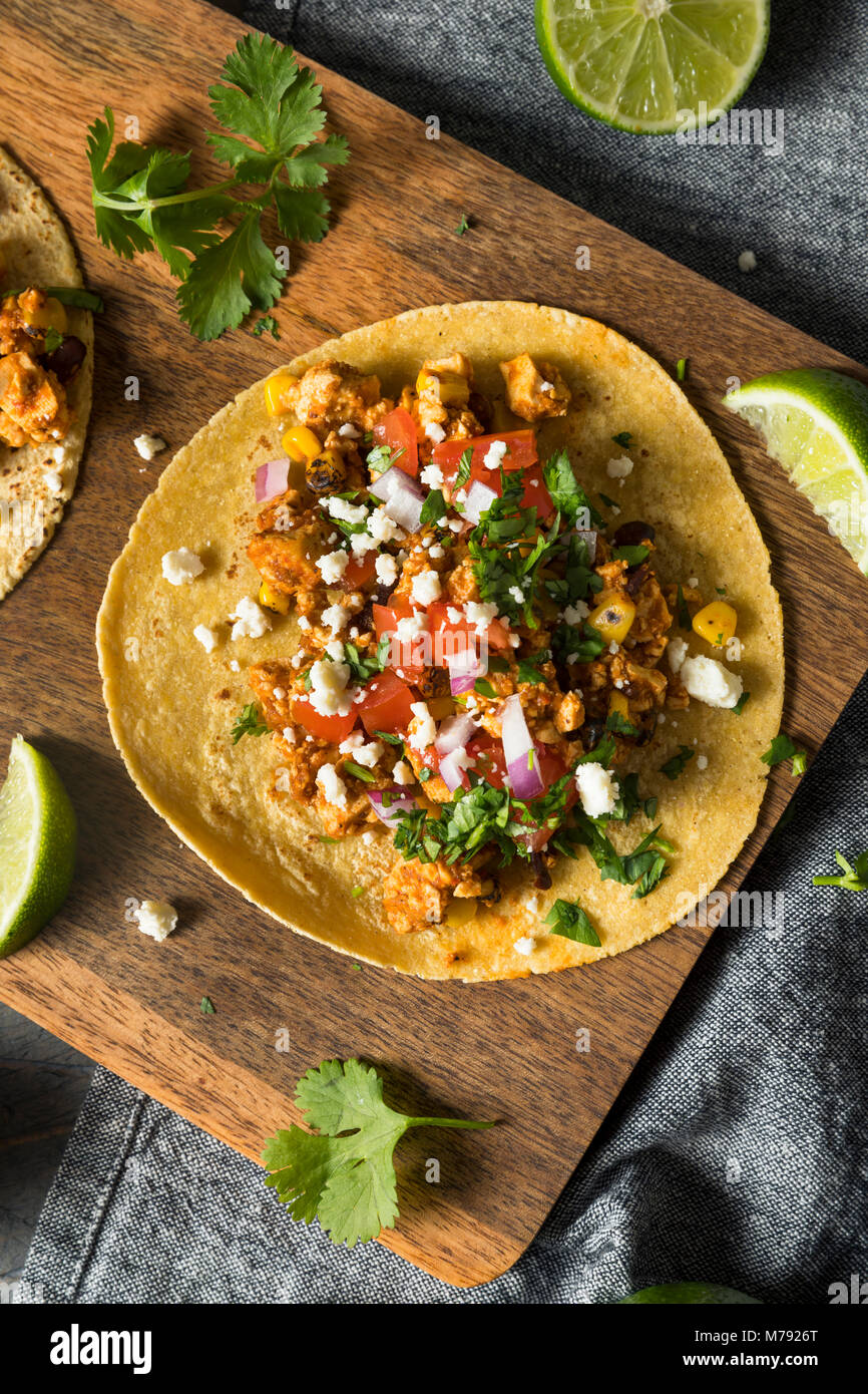 Healthy Homemade Sofritas Tofu Tacos with Tomato Onion and Cilantro - Stock Image