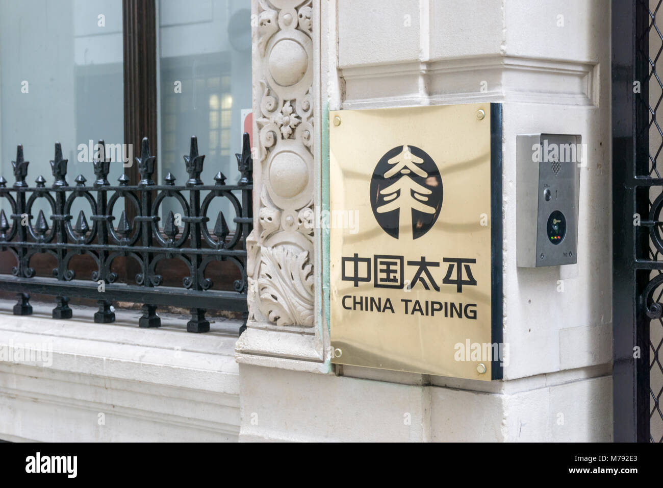 Brass nameplate for China Taiping Insurance Holdings Company in Finch Lane in the City of London. - Stock Image