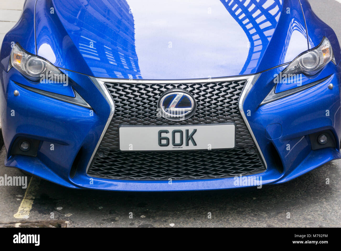 60K personalised number plates on a blue Lexus sports car in the City of London. - Stock Image