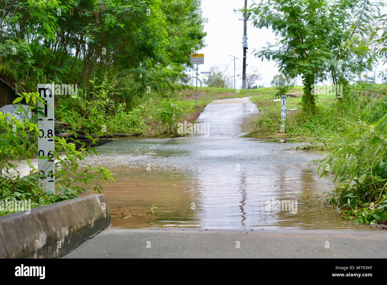 Flooded pedestrian and bike path after storms and heavy rainfall, near the bruce highway annandale, Townsville, - Stock Image