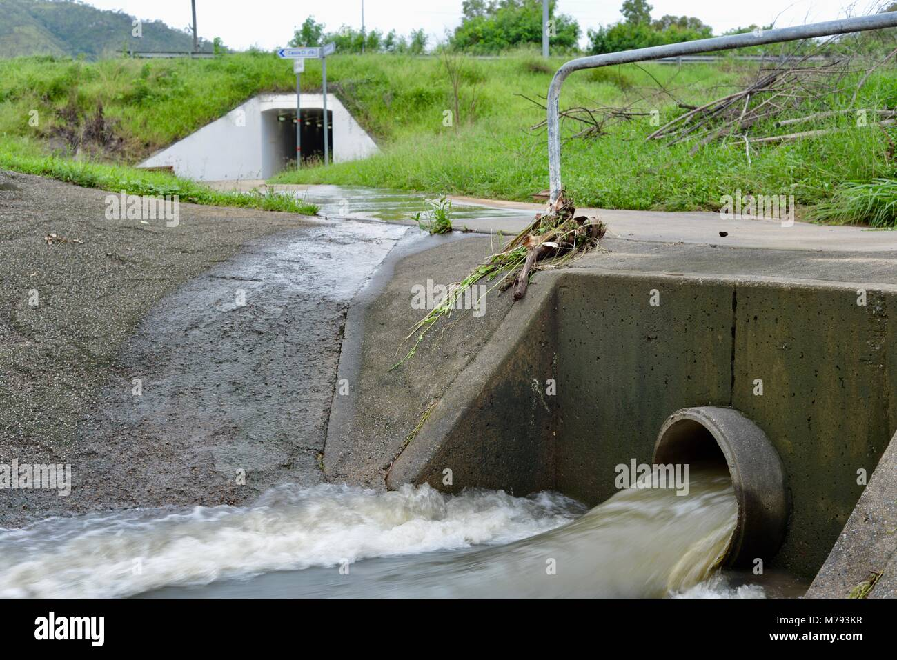 Water gushes out of a storm water drain after storms and