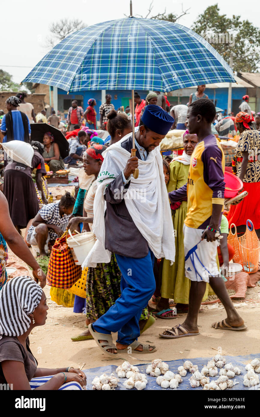 A Christian Priest Walking Through The Weekly Market In Jinka, Omo Valley, Ethiopia - Stock Image