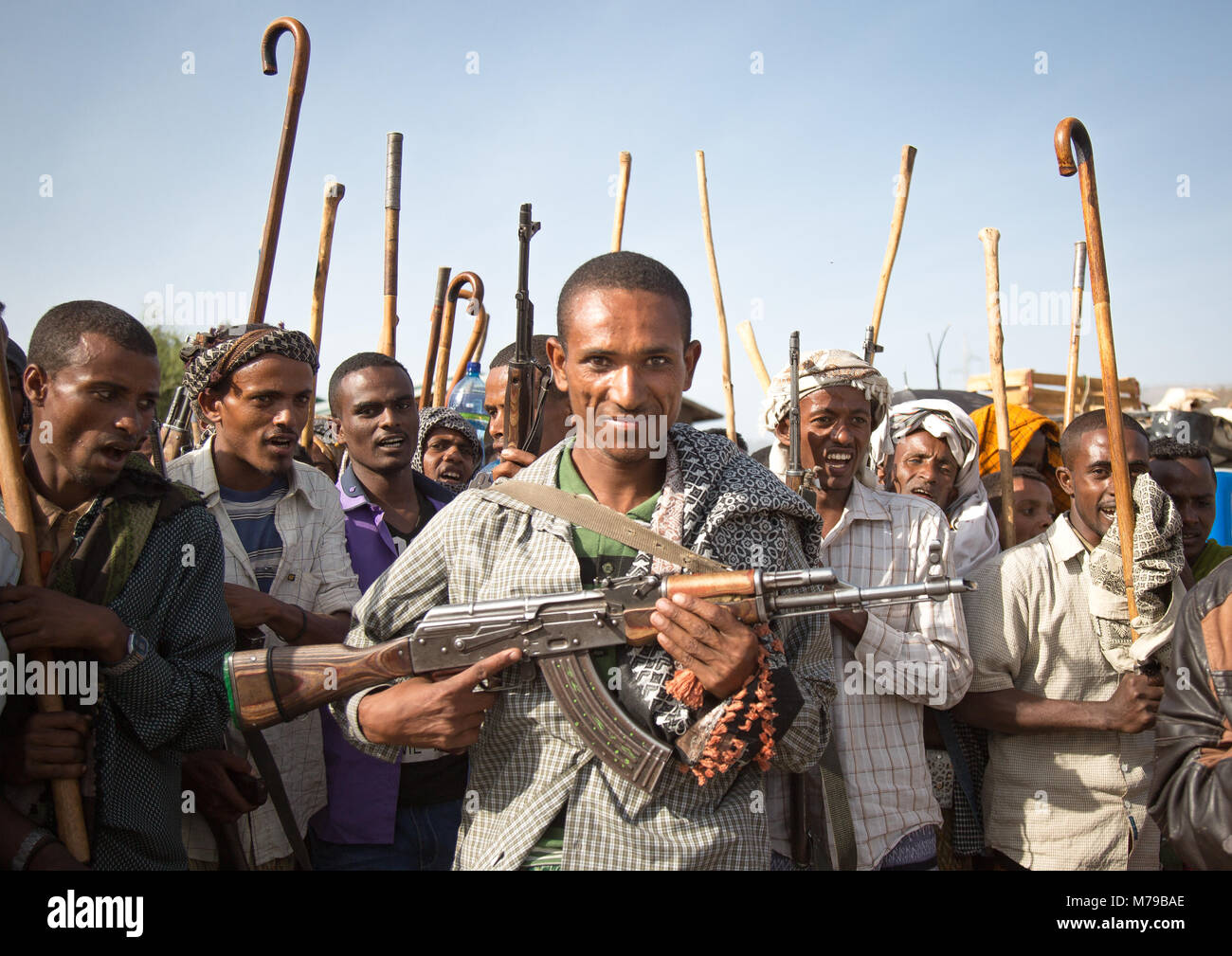 Oromo man proudly displaying his kalachnikov during a wedding here all men and boys are holding sticks, Canes and Stock Photo