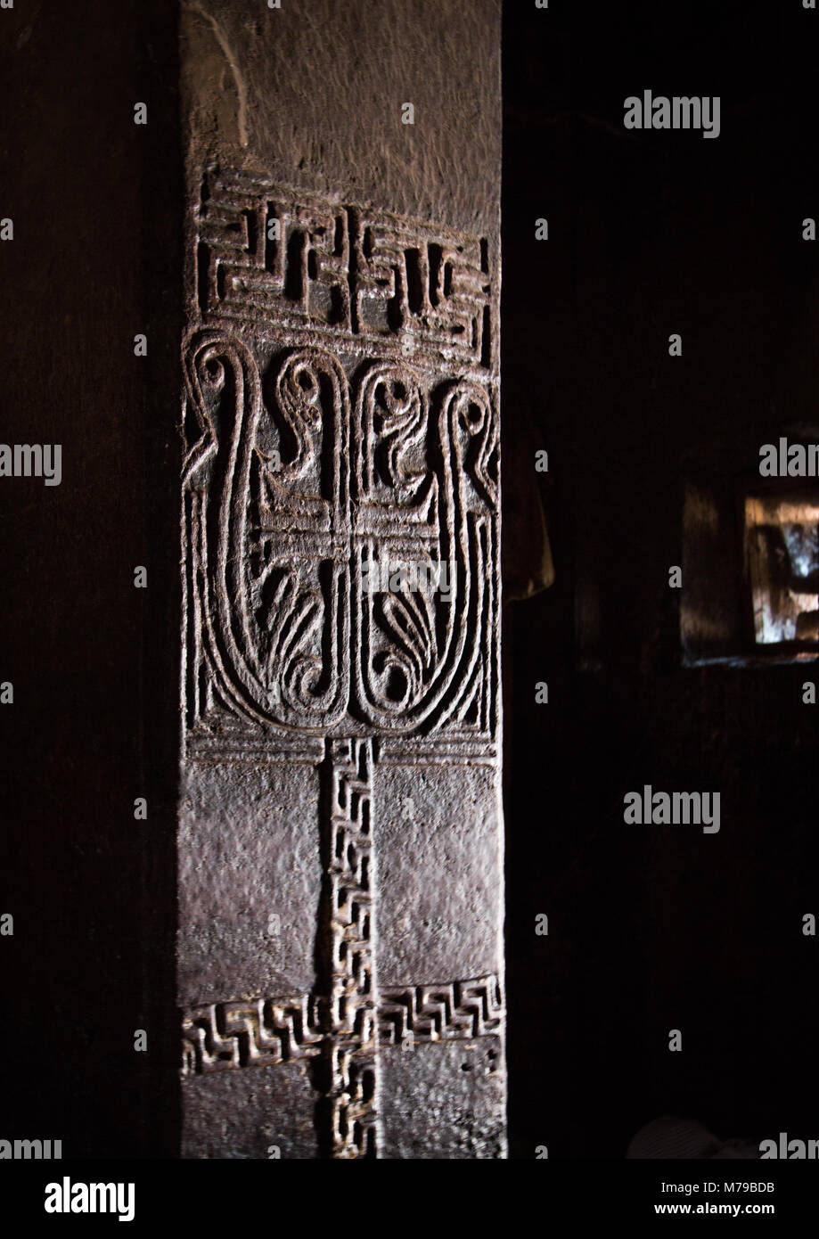 Carved column inside bet medhane alem, Amhara region, Lalibela, Ethiopia - Stock Image