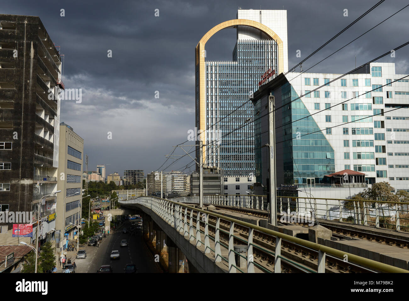 ETHIOPIA , Addis Ababa, LRT Light rail transport and office tower of Wegagen Bank, both build by chinese companies - Stock Image