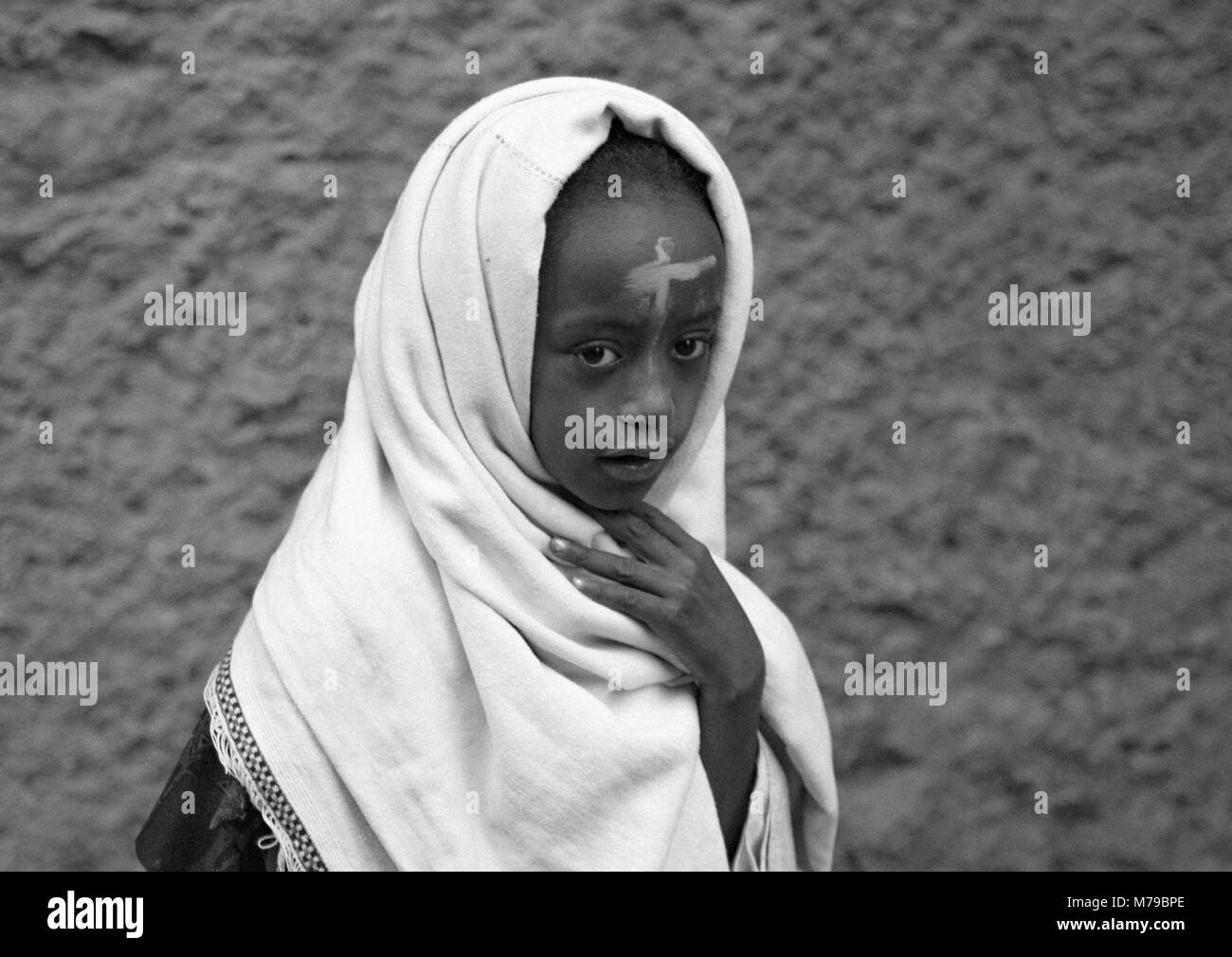Little  ethiopian girl with a cross sign on the forehead during kidane mehret orthodox celebration (st mary ceremony, - Stock Image
