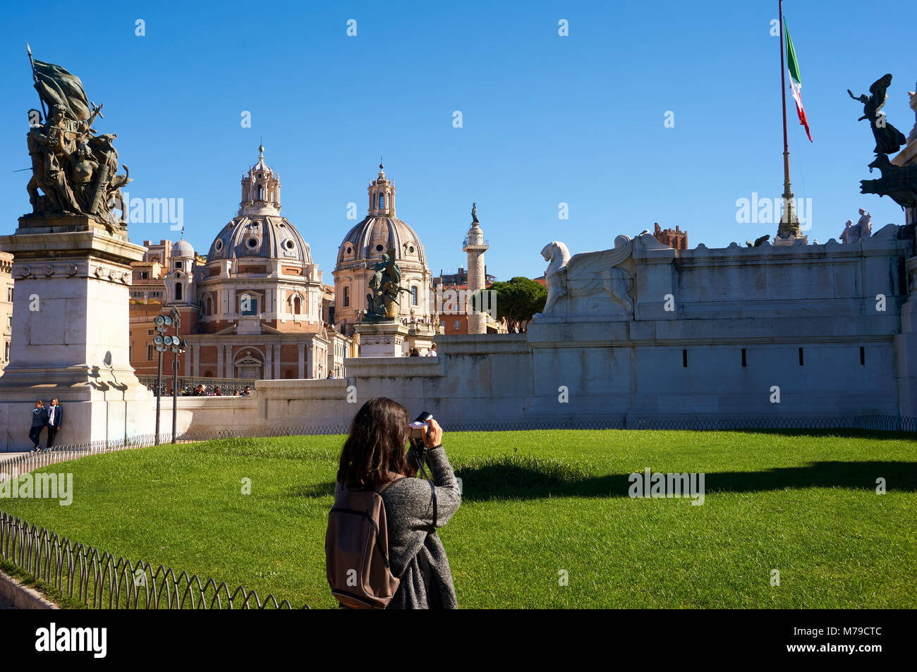 Rome, Italy - October 12, 2016: Girl taking photos of Palazzo Valentini Domus in Rome, Italy - Stock Image