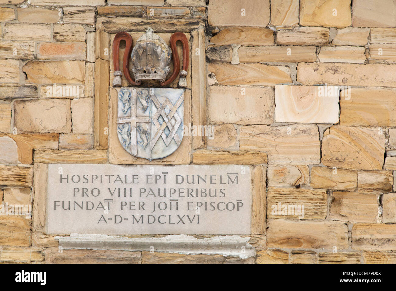 Inscription and coat of arms at the Paupers' Hospital in Durham City, England. The historic building dates from - Stock Image