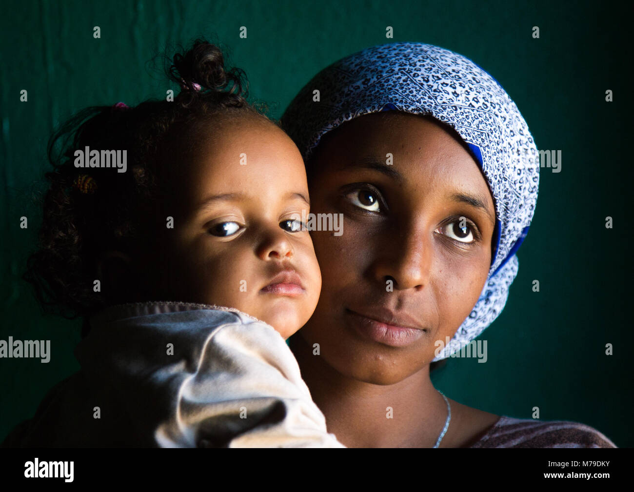 Sufi mother and her baby, Harari region, Harar, Ethiopia - Stock Image