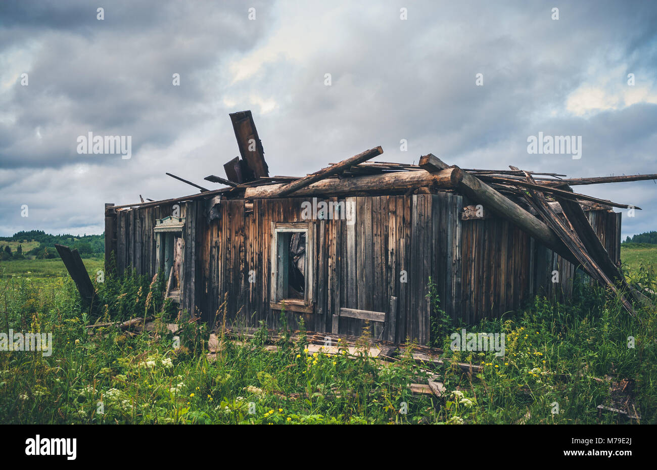 Old ruined wooden rural house. - Stock Image