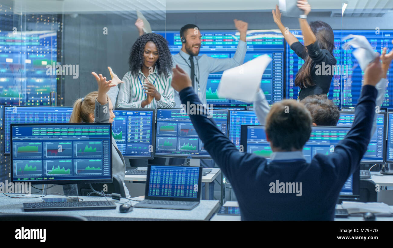 Multi-Ethnic Team of Traders Have Successful Day at the Stock Exchange Office. Dealers and Brokers Buy and Sell Stock Photo