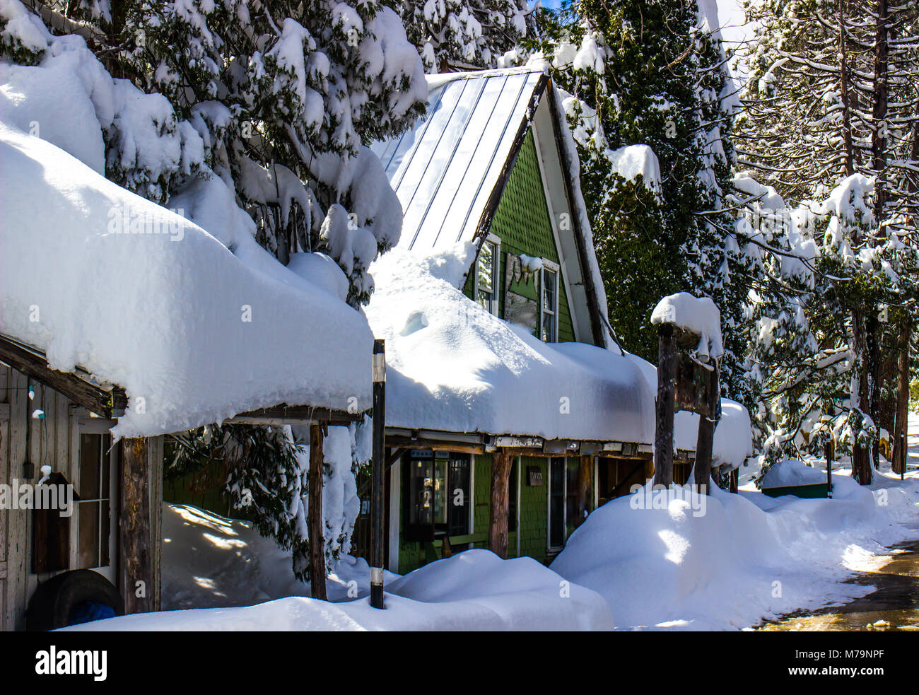 Mountain Building With Snow Heaped On Roof Stock Photo