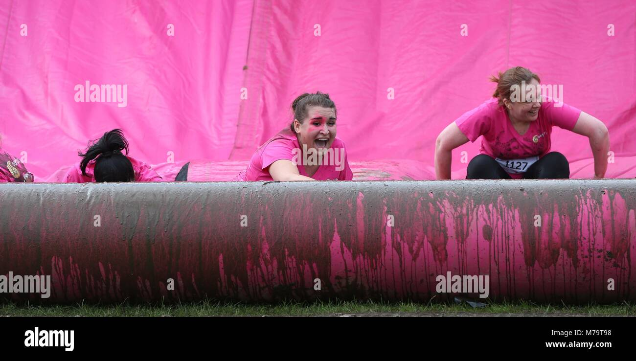 Women take part in the 'Pretty Muddy' charity run for Cancer Research UK  in Hammersmith on Wednesday 13 - Stock Image